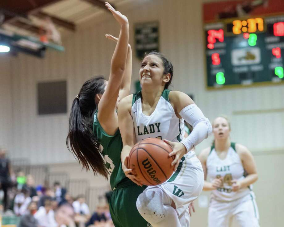 Kassie Chavez (21) goes up for a shot in the first half as the Legacy Christian Lady Warriors took on the Legacy Prep Lady Lions on February 4, 2020. Fran Ruchalski/The Enterprise Photo: Fran Ruchalski/The Enterprise / 2019 The Beaumont Enterprise