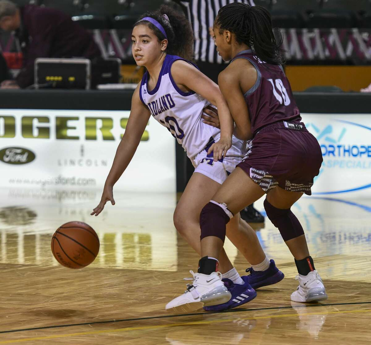 Lee's Destiny Stanford (10) guards Midland High's Madison Benavidez as she dribbles the ball Tuesday, Feb. 4, 2020 at Chaparral Center.