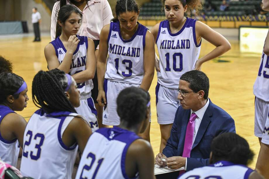 Midland High's head coach Wes Torres talks to his team during a timeout Tuesday, Feb. 4, 2020 at Chaparral Center. Photo: Jacy Lewis/Reporter-Telegram