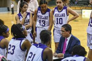 Midland High's head coach Wes Torres talks to his team during a timeout Tuesday, Feb. 4, 2020 at Chaparral Center.