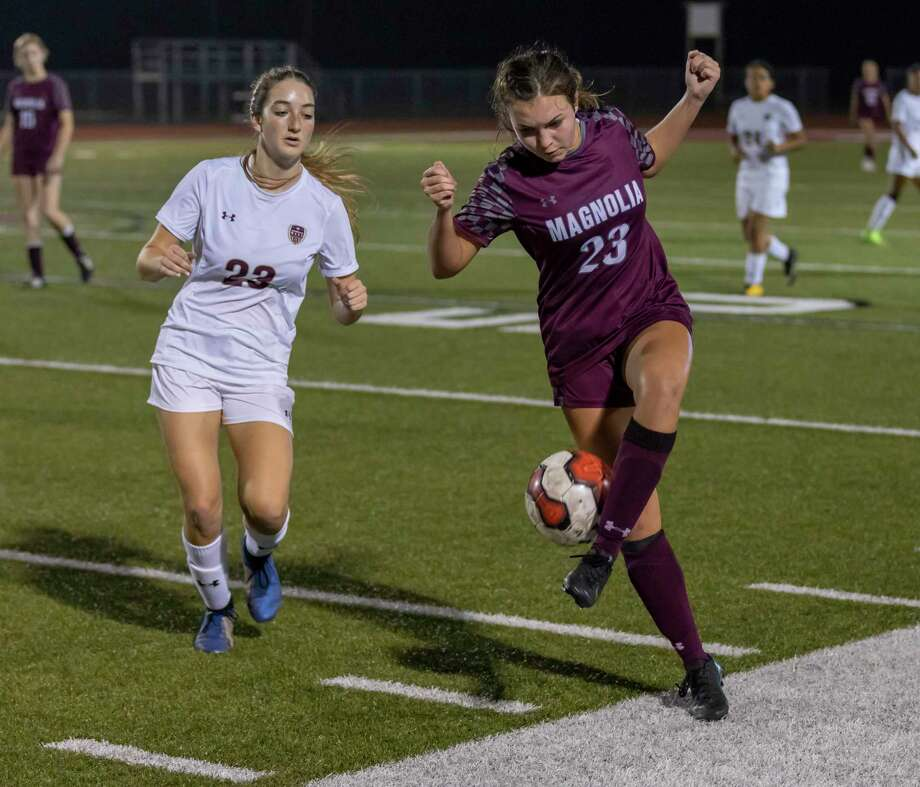 Magnolia soccer player Sammie Guidie (23) attempts to pass the ball while under pressure from Magnolia West soccer player Taylor Scott (23) in a 19-5A match in Magnolia, Tuesday, Feb. 4 , 2020. Photo: Gustavo Huerta, Houston Chronicle / Staff Photographer / Houston Chronicle
