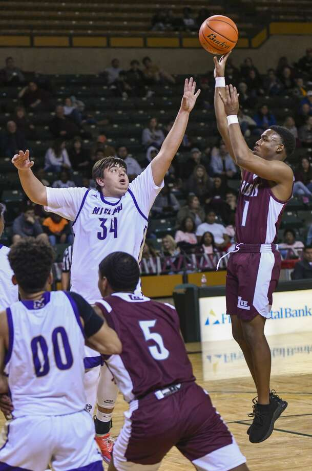Lee's Shemar Davis (1) shoots the ball as Midland High's Brett Canis (34) attempts to block the shot Tuesday, Feb. 4, 2020 at Chaparral Center. Photo: Jacy Lewis/Reporter-Telegram