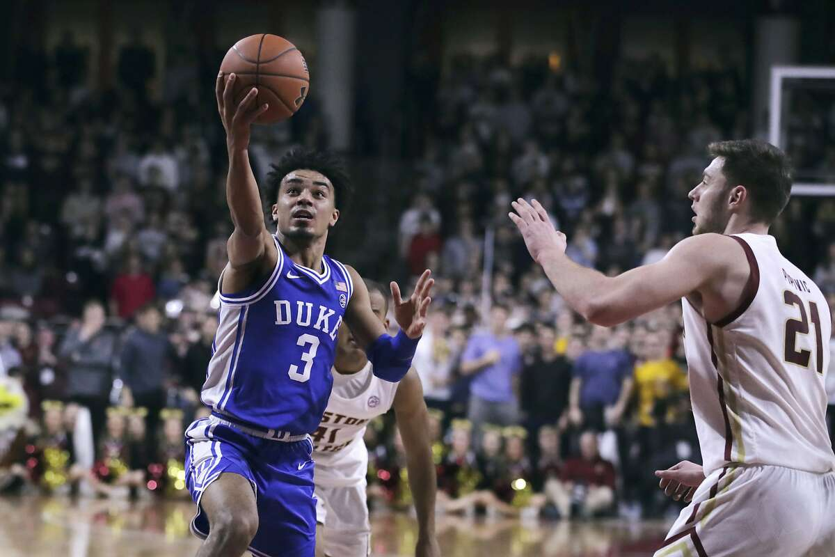 Duke guard Tre Jones (3) drives to the basket against Boston College forward Nik Popovic (21) during the first half of an NCAA college basketball game in Boston, Tuesday, Feb. 4, 2020. (AP Photo/Charles Krupa)