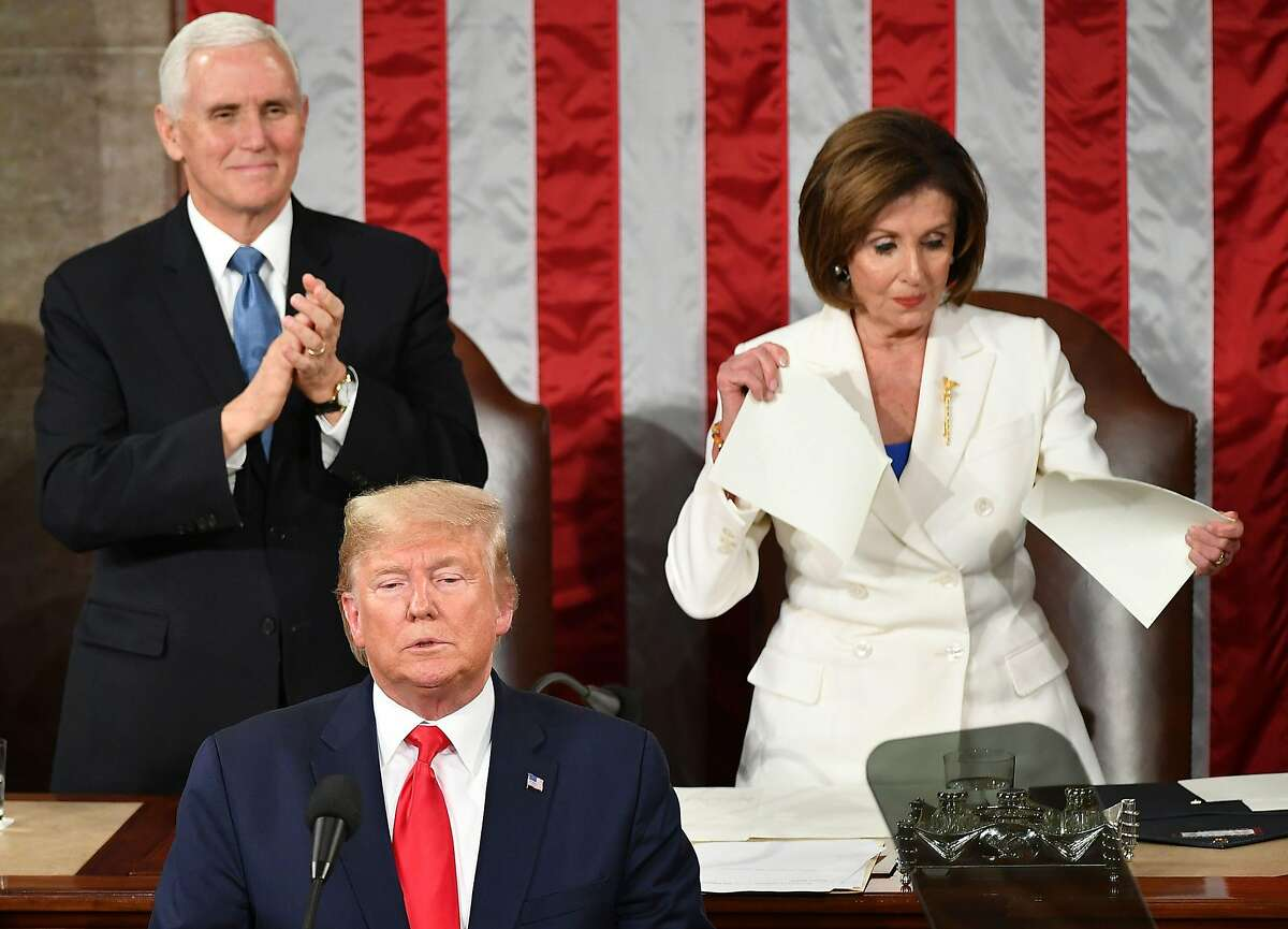 US Vice President Mike Pence claps as Speaker of the US House of Representatives Nancy Pelosi appears to rip a copy of US President Donald Trumps speech after he delivers the State of the Union address at the US Capitol in Washington, DC, on February 4, 2020. (Photo by MANDEL NGAN / AFP) (Photo by MANDEL NGAN/AFP via Getty Images)