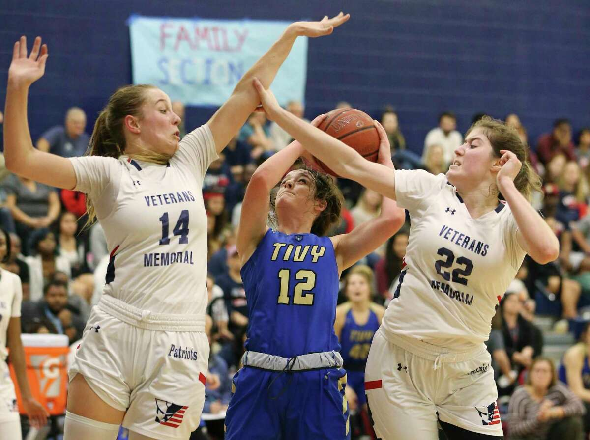 Veterans Memorial's Brenna Perez (14) and Marley Rokas (22) apply defensive pressure against Kerrville Tivy's Audrey Robertson (12) during their girls basketball game on Tuesday, Feb. 4, 2020. Veterans Memorial defeated Tivy, 63-39, to win the District 26-5A title.