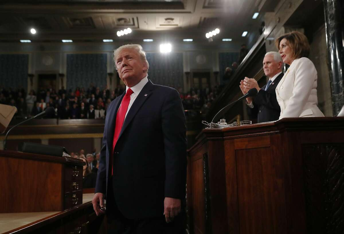 WASHINGTON, DC - FEBRUARY 04: U.S. President Donald Trump arrives as House Speaker Nancy Pelosi and Vice President Mike Pence look on before the State of the Union address in the House chamber on February 4, 2020 in Washington, DC. Trump is delivering his third State of the Union address on the night before the U.S. Senate is set to vote in his impeachment trial. (Photo by Leah Millis-Pool/Getty Images)