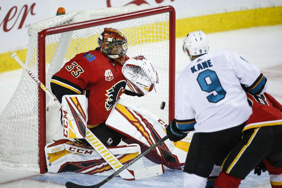Sharks winger Evander Kane scores on Flames goalie David Rittich during the second period of San Jose's 3-1 win in Calgary. Photo: Jeff McIntosh / Associated Press