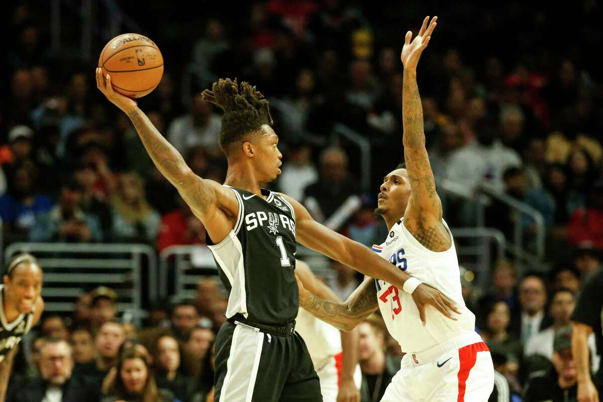 Lonnie Walker IV, left, has the physical tools to one day become an elite defender, but he has started only four games in two seasons.