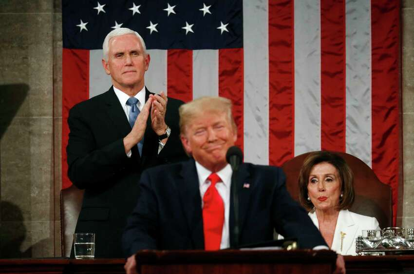 President Donald Trump delivers his State of the Union address to a joint session of Congress in the House Chamber on Capitol Hill in Washington, Tuesday, Feb. 4, 2020, as Vice President Mike Pence and Speaker Nancy Pelosi look on. (Leah Millis/Pool via AP)