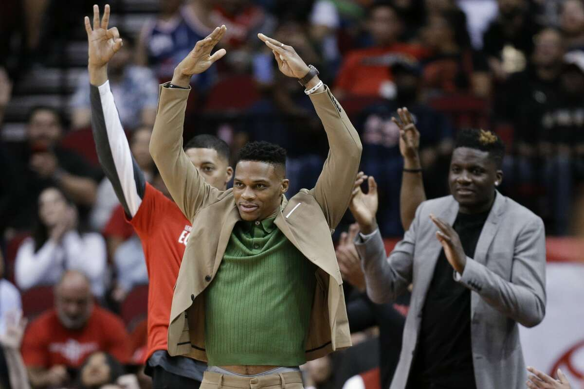 Houston Rockets guard Russell Westbrook, center, reacts after a three point basket during the second half of an NBA basketball game against the Charlotte Hornets, Tuesday, Feb. 4, 2020, in Houston. (AP Photo/Eric Christian Smith)