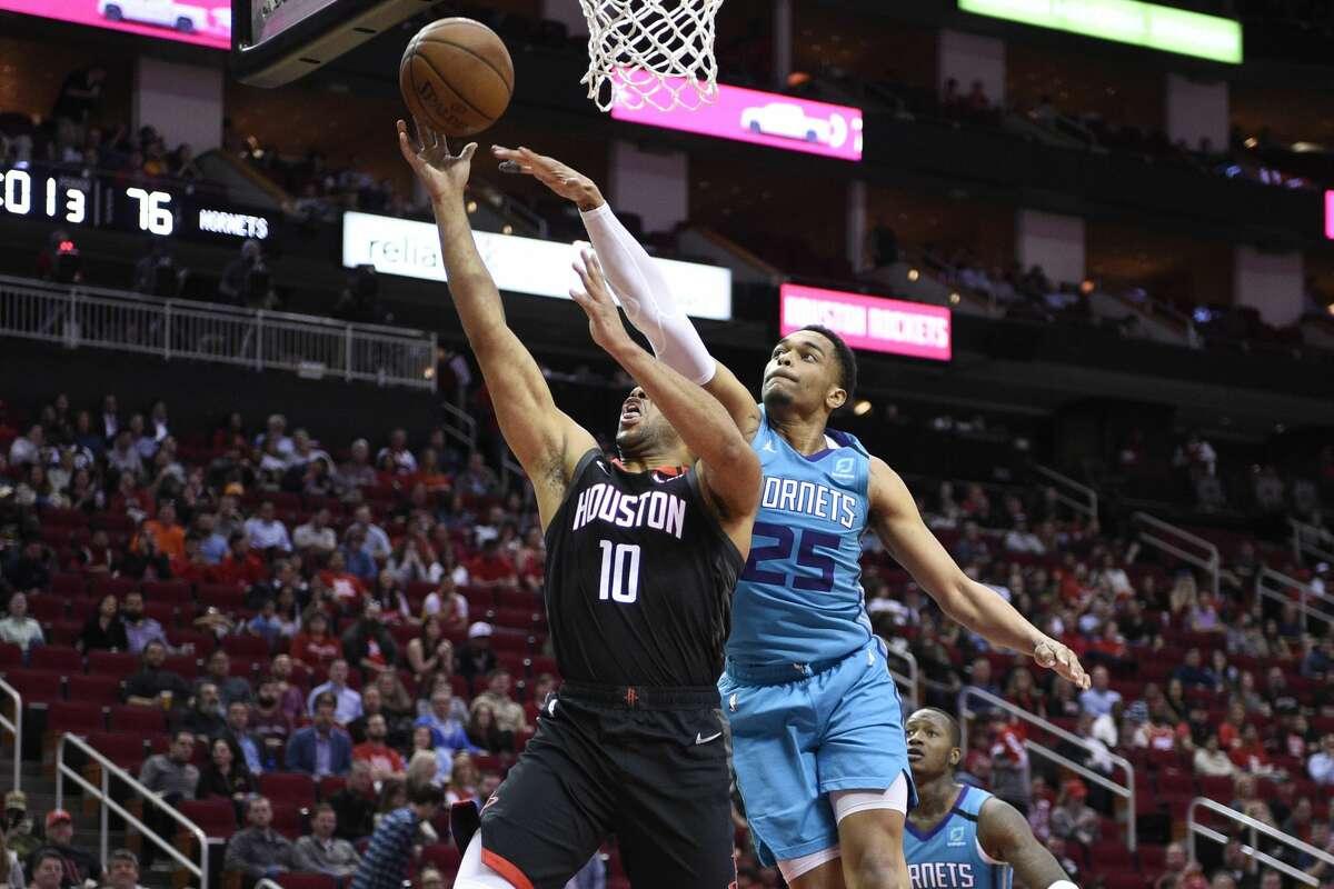Houston Rockets guard Eric Gordon (10) shoots as Charlotte Hornets forward PJ Washington defends during the second half of an NBA basketball game Tuesday, Feb. 4, 2020, in Houston. (AP Photo/Eric Christian Smith)