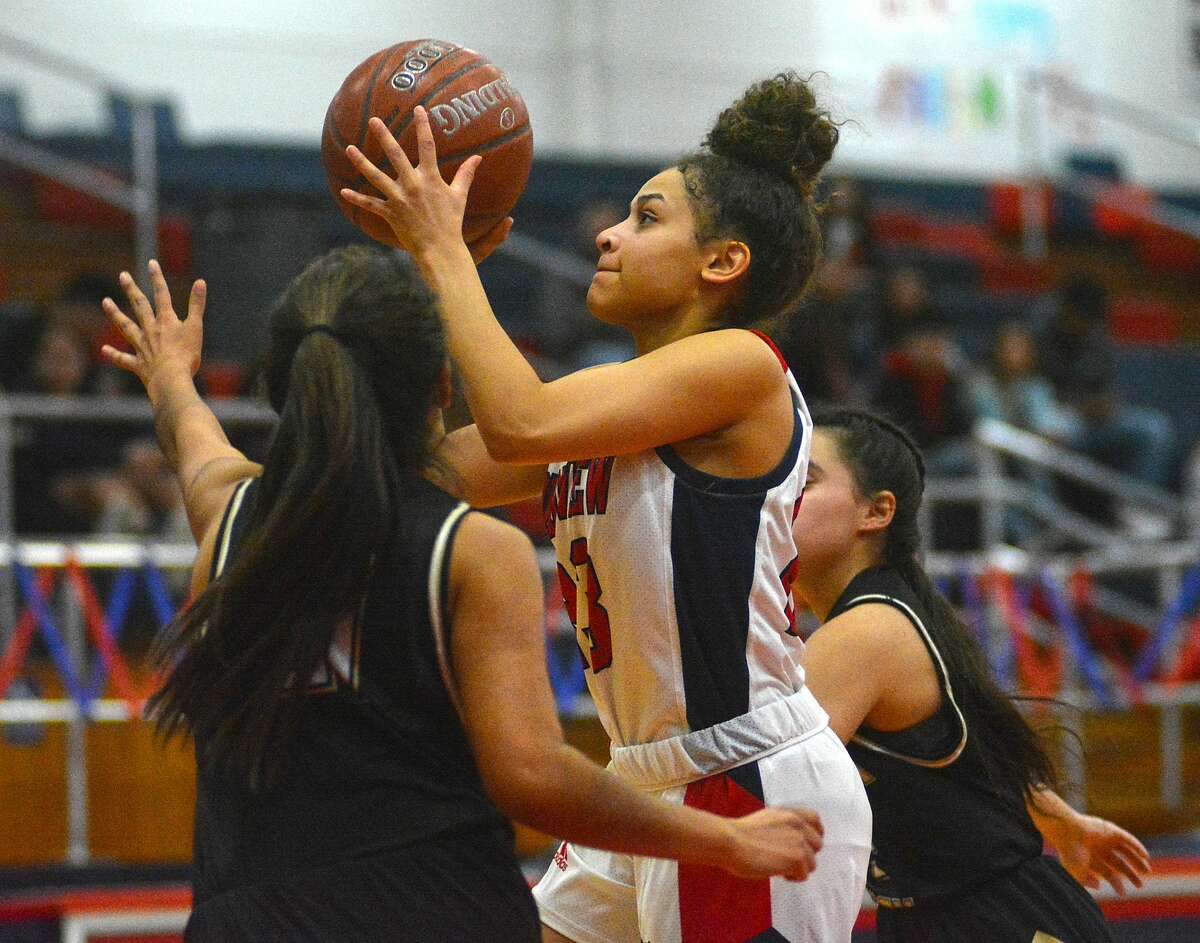 Plainview's Osen Ellis puts up the shot between a pair of Lubbock defenders during their District 3-5A girls basketball game on Tuesday, Feb. 4, 2020 in the Dog House.