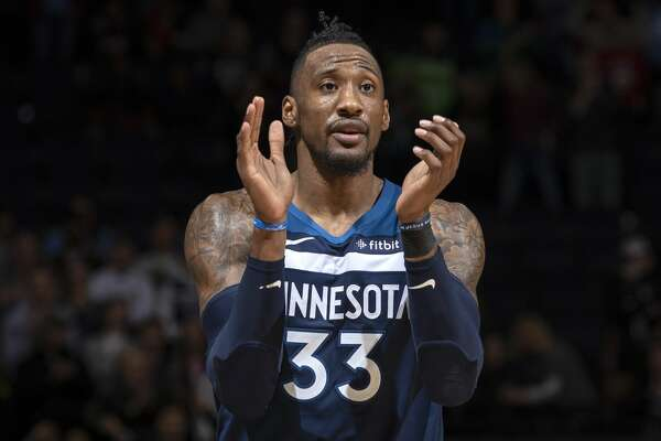Minneapolis, MN-December 30: Minnesota Timberwolves Robert Covington (33) celebrated in the final seconds of overtime against Brooklyn Nets. (Photo by Carlos Gonzalez/Star Tribune via Getty Images)