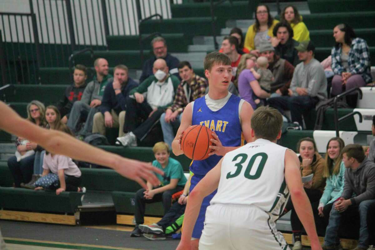 Evart basketball player Donavin Reagan (with ball) is among the top athletes for winter sports at his school. Evart and other area schools have been dealing with flu issues this season. (Herald Review file photo)