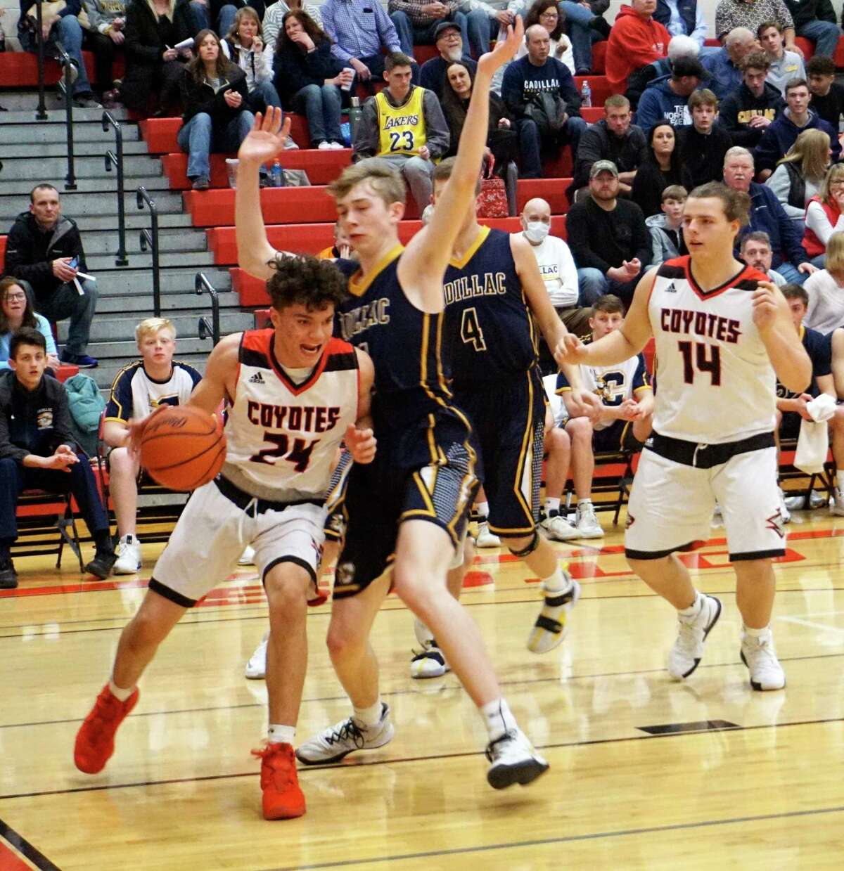 Reed City freshman Xavier Allen battles to stay inbounds along the baseline during the Coyotes' 76-34 loss to Cadillac on Jan. 29 at RCHS. (Herald file photo/Joe Judd)