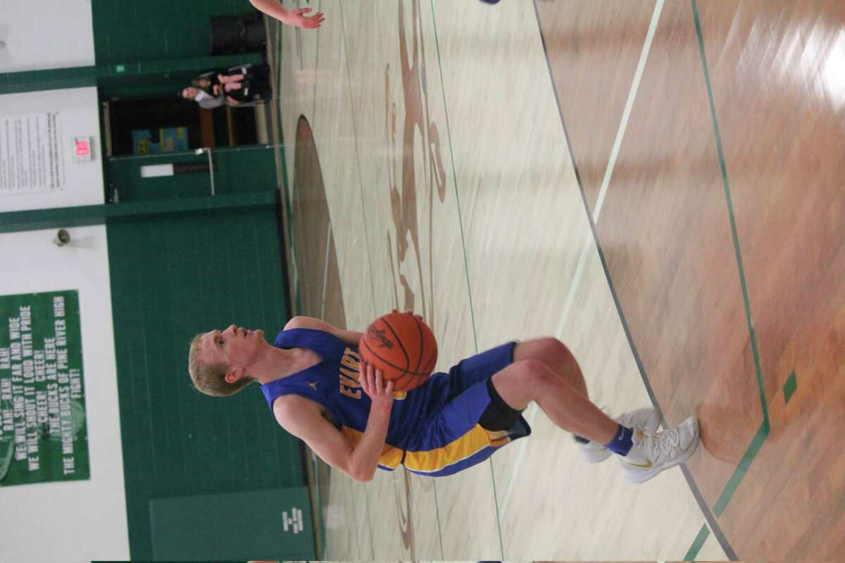 Evart's Cam Brasington looks to make a move in recent action. (Herald Review file photo)
