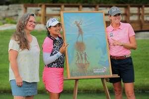 From left, Barbara Plezia, winner of the 2019 Dow GLBI Trophy Design Contest,poses with 2019 Dow GLBI Champions Jasmine Suwannapura and Cydney Clanton next to the 2019 winning trophy design. (Photo provided)