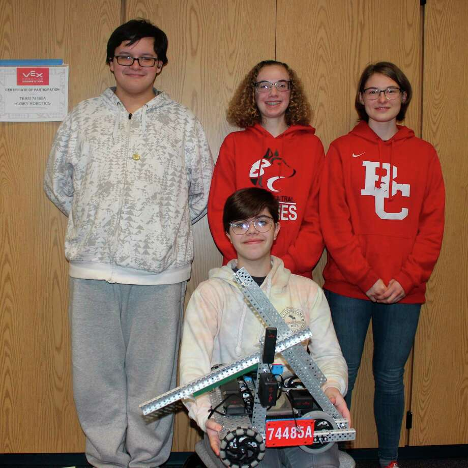 Benzie Central's high school robotic team, featuringEmily Fouchey holding the team robot (front) and back row (left to right) Parker Miller, Jessica Decker and Ella Gaylordwill be one of many teams competing in the weekend tournament. (File photo)