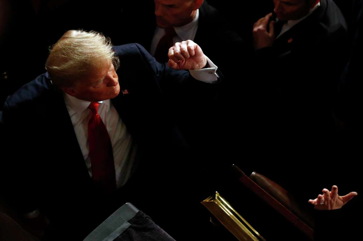 President Donald Trump greets people after delivering his State of the Union address to a joint session of Congress on Capitol Hill in Washington, Tuesday, Feb. 4, 2020.