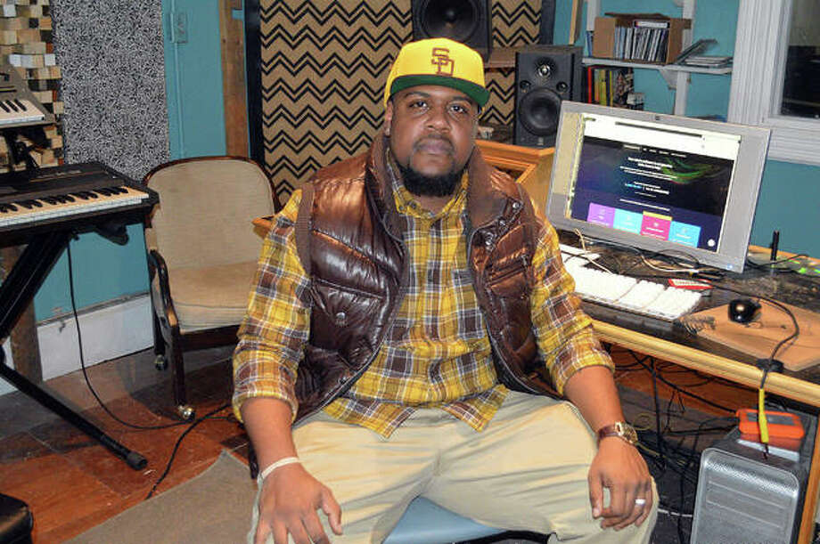 Hip hop artist Rec Riddles sits in the control room at Bird Cloud Recording in Edwardsville, where he recorded several of his albums. Riddles, of Glen Carbon, started his professional music career in Newark, New Jersey. Photo: Scott Marion|Hearst Illinois
