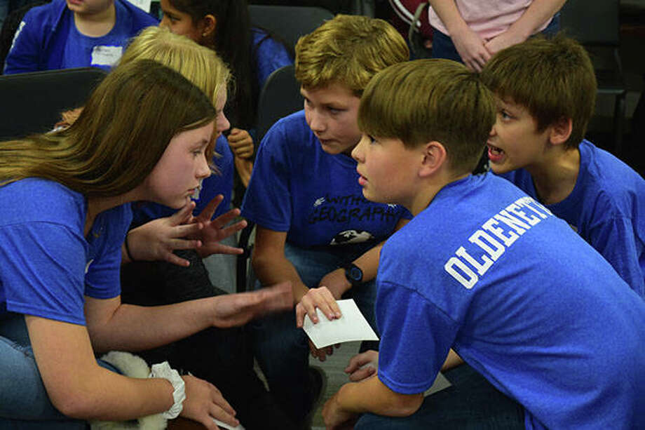 South Jacksonville Elementary student Kellon Oldenettel (right) talks with team member Olivia Dobson during the 2019 Regional Geography Bowl. Oldenettel was honored Tuesday with one of two Prudential Spirit of Community Awards in the state. Photo: Marco Cartolano | Journal-Courier