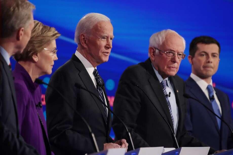 DES MOINES, IOWA - JANUARY 14: Tom Steyer (L), Sen. Elizabeth Warren (D-MA), former Vice President Joe Biden, Sen. Bernie Sanders (I-VT) and former South Bend, Indiana Mayor Pete Buttigieg (R) participate in the Democratic presidential primary debate at Drake University on January 14, 2020 in Des Moines, Iowa. Six candidates out of the field qualified for the first Democratic presidential primary debate of 2020, hosted by CNN and the Des Moines Register. (Photo by Scott Olson/Getty Images) Photo: Scott Olson/Getty Images
