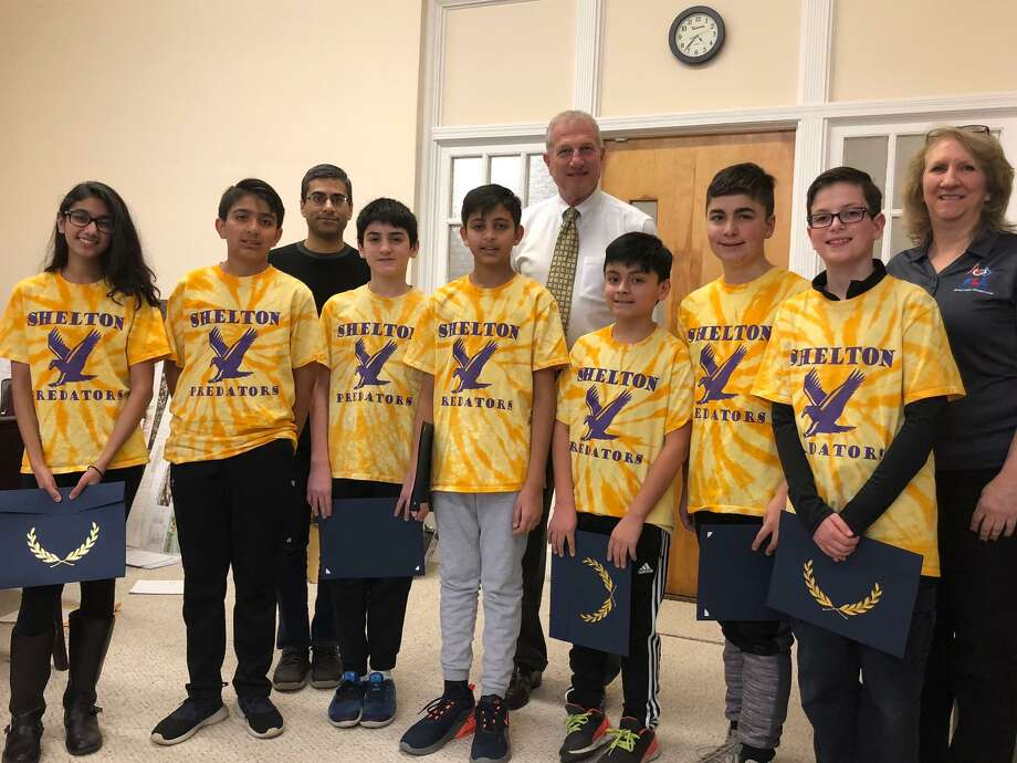 Mayor Mark Lauretti honored the state champion Predators' robotics team Thursday, Jan. 30. Pictured with Lauretti and the Predators is team adviser Laurie Vogl and coach Svapan Makadia. Photo: Brian Gioiele / Hearst Connecticut Media / Connecticut Post
