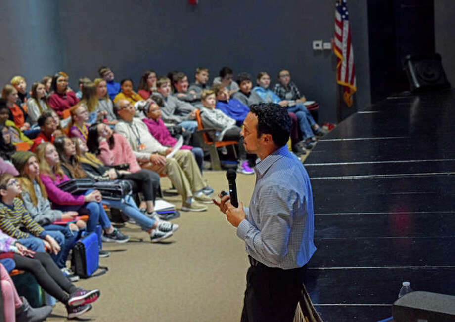 Sixth-grade students at Lincoln Middle School listen as KSDK meteorologist, Anthony Slaughter gives a presentation on weather Tuesday morning. Photo: Tyler Pletsch|The Intelligencer