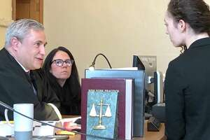Angela Kelley, right, an attorney with the Albany County Public Defender's Office, argued with Cohoes City Court Judge Thomas Marcelle on Wednesday, Feb. 5, that he did not have the authority under law to set bail for her client, who is charged with aggravated unlicensed operation of a motor vehicle. Marcelle issued a decision in the case challenging the constitutionality of a new law that prohibits judges from setting bail for non-violent offenses.