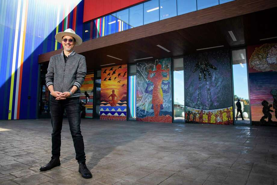 Houston artist Angel Quesada during the unveiling of his new mural outside of Legacy Community Health. Photo: Annie Mulligan, Houston Chronicle / Contributor / © 2020 Annie Mulligan / Houston Chronicle