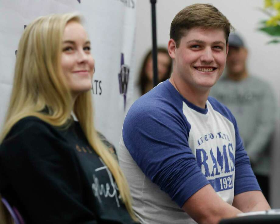 Connor Fisher, right, laughs with friends and family beside Isabelle Sundquist during a National Signing Day ceremony at Willis High School, Wednesday, Feb. 5, 2020, in Willis. Fisher signed to play football for Angelo State, while Sundquist signed to play volleyball for UT-Dallas. Photo: Jason Fochtman, Houston Chronicle / Staff Photographer / Houston Chronicle © 2020