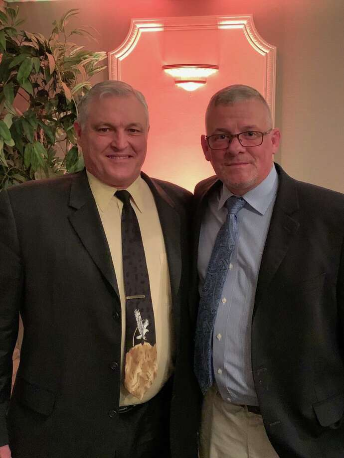 The Trumbull TD Club presented its Lasting Impact Award to Mike Herbst at its annual Parent Dinner Dance. Presenting the award to Herbst is Trumbull wrestling coach Charlie Anderson. Photo: Contributed Photo / Trumbull High Athletics / Trumbull Times