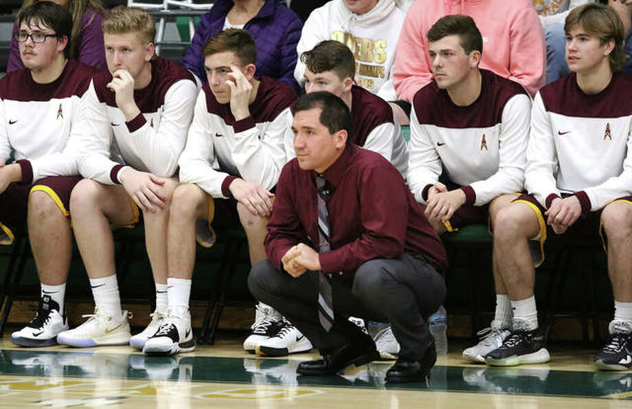 EA-WR coach Steve Flowers watches from in front of his team's bench during a game at the Metro-East Lutheran Tournament on Nov. 26. The Oilers have won three of their last four games after Tuesday win over Southwestern in Wood River. Photo: Greg Shashack / The Telegraph