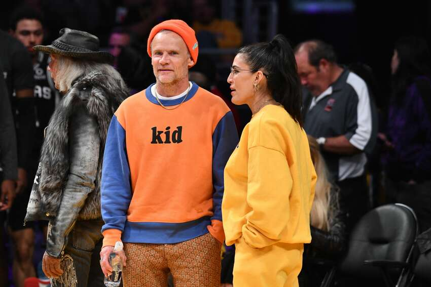 LOS ANGELES, CALIFORNIA - FEBRUARY 04: Musician Flea and Melody Ehsani attend a basketball game between the Los Angeles Lakers and the San Antonio Spurs at Staples Center on February 04, 2020 in Los Angeles, California. (Photo by Allen Berezovsky/Getty Images)