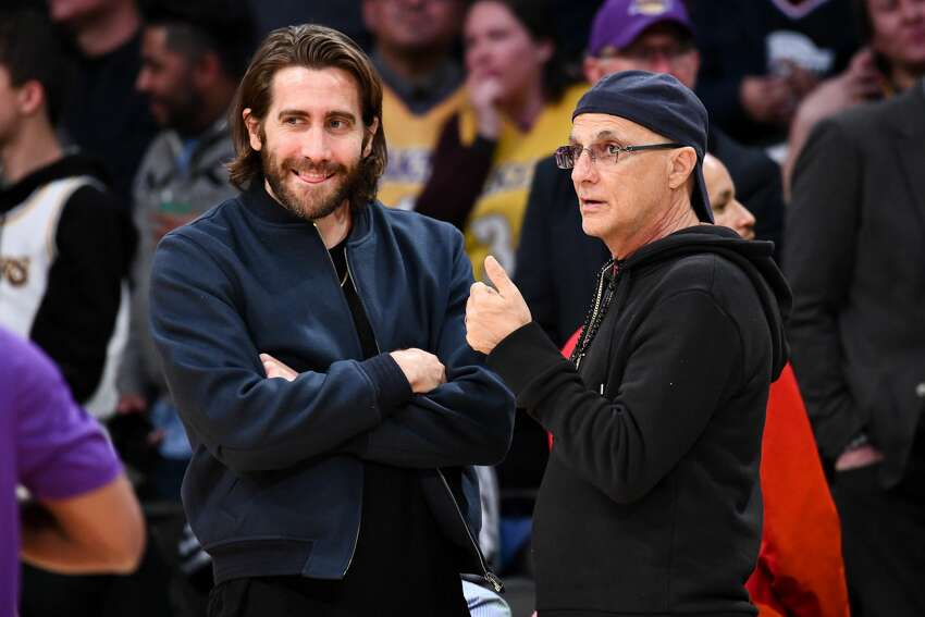 LOS ANGELES, CALIFORNIA - FEBRUARY 04: Jake Gyllenhaal (L) and Jimmy Iovine attend a basketball game between the Los Angeles Lakers and the San Antonio Spurs at Staples Center on February 04, 2020 in Los Angeles, California. (Photo by Allen Berezovsky/Getty Images)