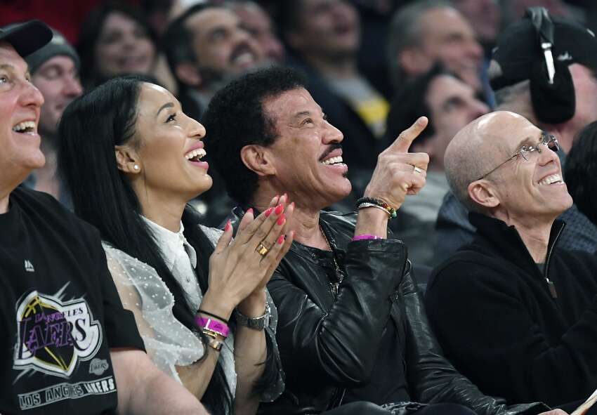 LOS ANGELES, CA - FEBRUARY 04: Lisa Parigi (L), singer Lionel Richie and film producer Jeffrey Katzenberg attend the Los Angeles Lakers and San Antonio Spurs at Staples Center on February 4, 2020 in Los Angeles, California. NOTE TO USER: User expressly acknowledges and agrees that, by downloading and/or using this Photograph, user is consenting to the terms and conditions of the Getty Images License Agreement. (Photo by Kevork Djansezian/Getty Images)