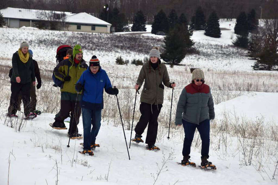 About 45 people signed up to walk in the Snowshoe Stampede that took place south of West Merkey Road in Manistee. The event also featured a chili cookoff, live music and a corn hole tournament at the Veterans of Foreign Wars building on 28th Street Saturday. Photo: Arielle Breen/News Advocate Photo