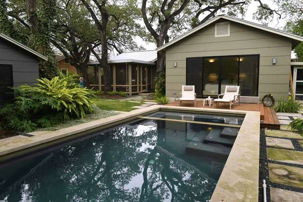 The Debra Maltz and Tonio Athens renovated their Alamo Heights home to make it more comfortable and serve them well as they age. Their backyard includes a swimming pool off the master bedroom and a handsome screened-in porch adjacent to the living room.