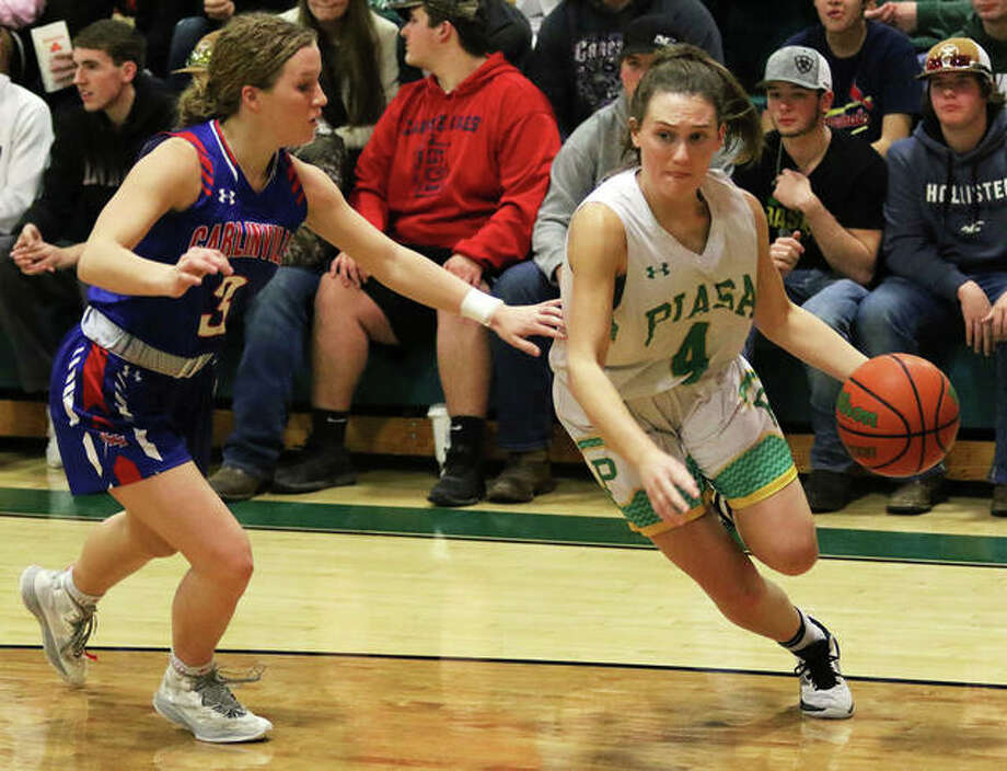 Southwestern's Josie Bouillon (right), shown driving on Carlinville's Eryn Seal in a Jan. 9 SCC game in Piasa, hit four 3-pointers in the second half to lead the Birds to a SCC victory Tuesday night in Staunton. Photo: Greg Shashack / The Telegraph
