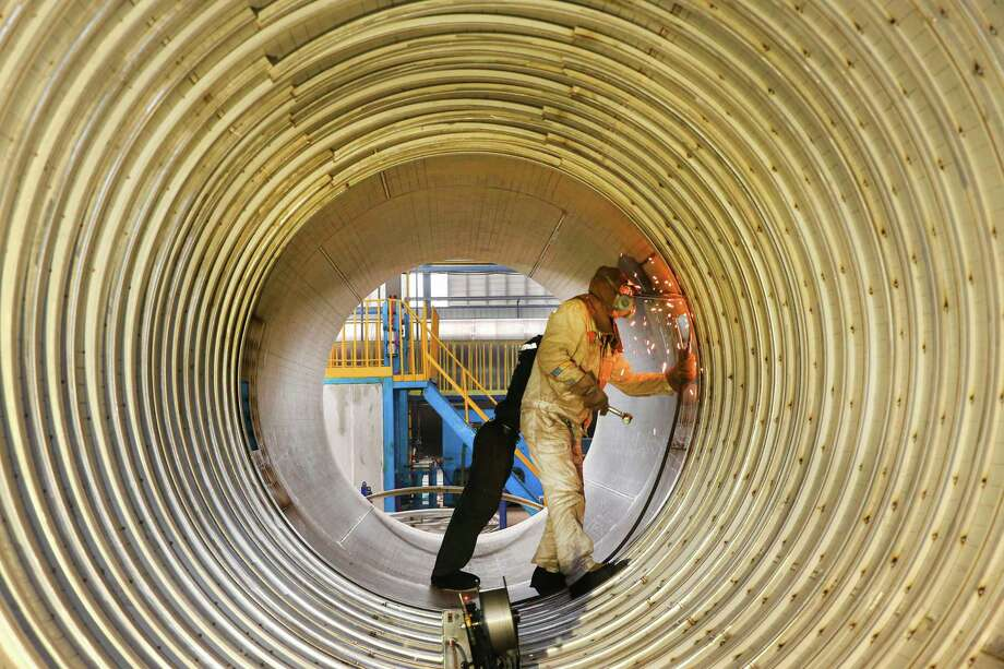 A worker welds a liquefied natural gas tank in March 2019 in Nantong. Texas drillers are looking to China, with its massive population and juggernaut growth, to drive demand for their crude and natural gas for decades to come. But China is moving rapidly to develop its own energy sector. (Getty Images) / AFP or licensors