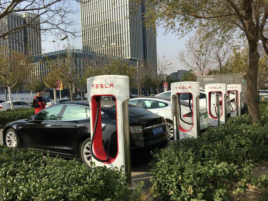 A Tesla charging station stands in Suzhou, where electric vehicles are becoming increasingly common. Photo: James Osborne,  Staff / © 2020 Houston Chronicle