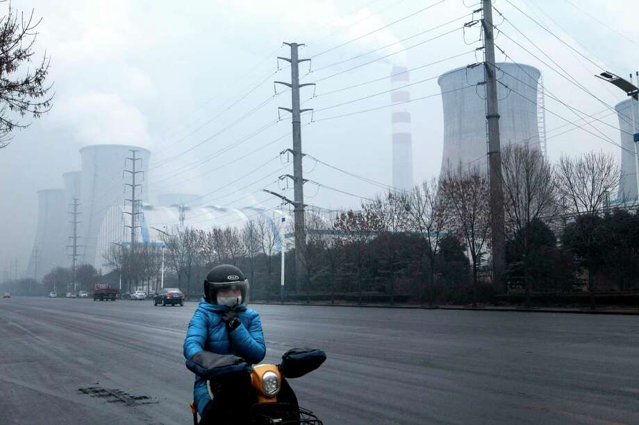 A coal-fired power plant operates in 2018 in Zouping, Shandong province. In cities across China, residents still choke on smog so thick that the color of the sky shifts between gray and murky yellow, a relic of a coal-dominated economy and a government that was slow to regulate air pollution. (Giulia Marchi | The New York Times) / NYTNS
