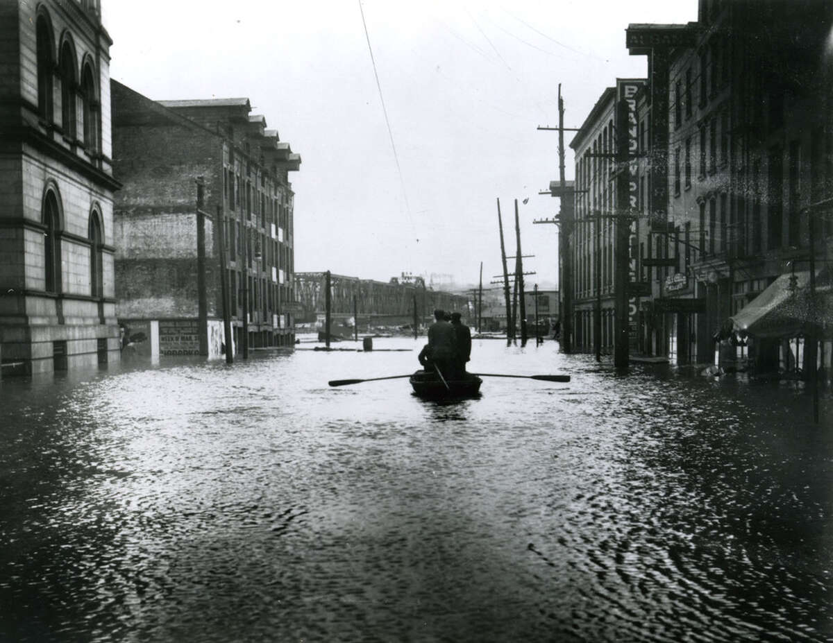 People take to their boat to navigate floodwaters in Albany on State Street below Broadway in this undated photo, taken prior to the flood control dams which were built in the early 20th century. Click through to take a stroll through time along one of Albany's most notable streets.