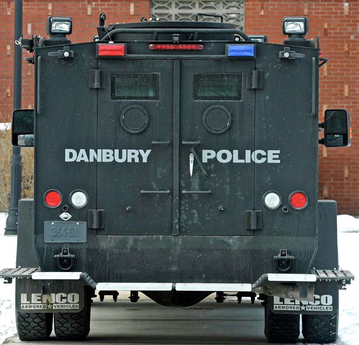 A Danbury Police Department Emergency Services Unit is parked next to Litchfield Hall during a Western Connecticut State University Police Department live shooting exercise with Danbury and other area police departments at the WCSU midtown campus Campus on Thursday, February 11, 2016, in Danbury, Conn. The training drill took place in the university's Litchfield Hall dormitory building.