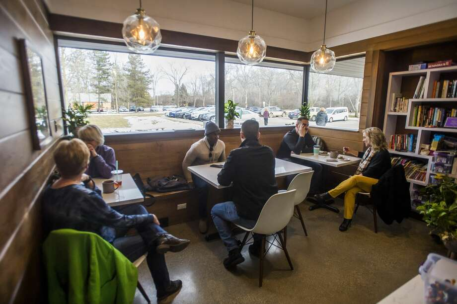 Grove Tea Lounge celebrates its one year anniversary with a ribbon cutting along with the Midland Business Alliance Tuesday, Feb. 4, 2020. (Katy Kildee/kkildee@mdn.net) Photo: (Katy Kildee/kkildee@mdn.net)