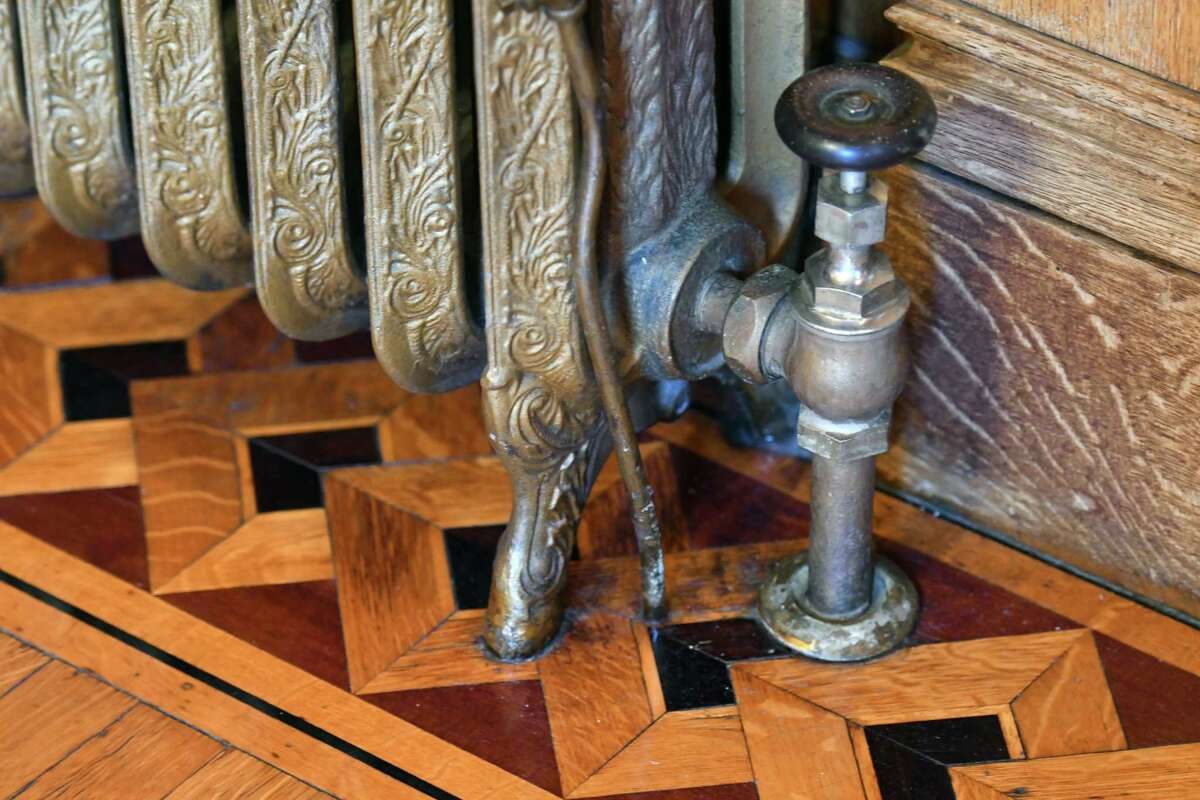 """Radiator and inlaid floor detail inside Karin Krasevac-Lenz's Second Street home on Tuesday, Feb. 4, 2020, in Troy, N.Y. The Hart Cluett Museum executive director hopes her home will be featured in a new HBO production titled """"The Gilded Age,"""" written by the writer for """"Downton Abbey."""" Filming is slated for June. (Will Waldron/Times Union)"""