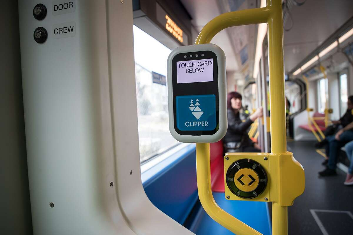 A Clipper card reader and manual door button on a new Muni Metro light rail car on Monday, March 12, 2018 in San Francisco, CA