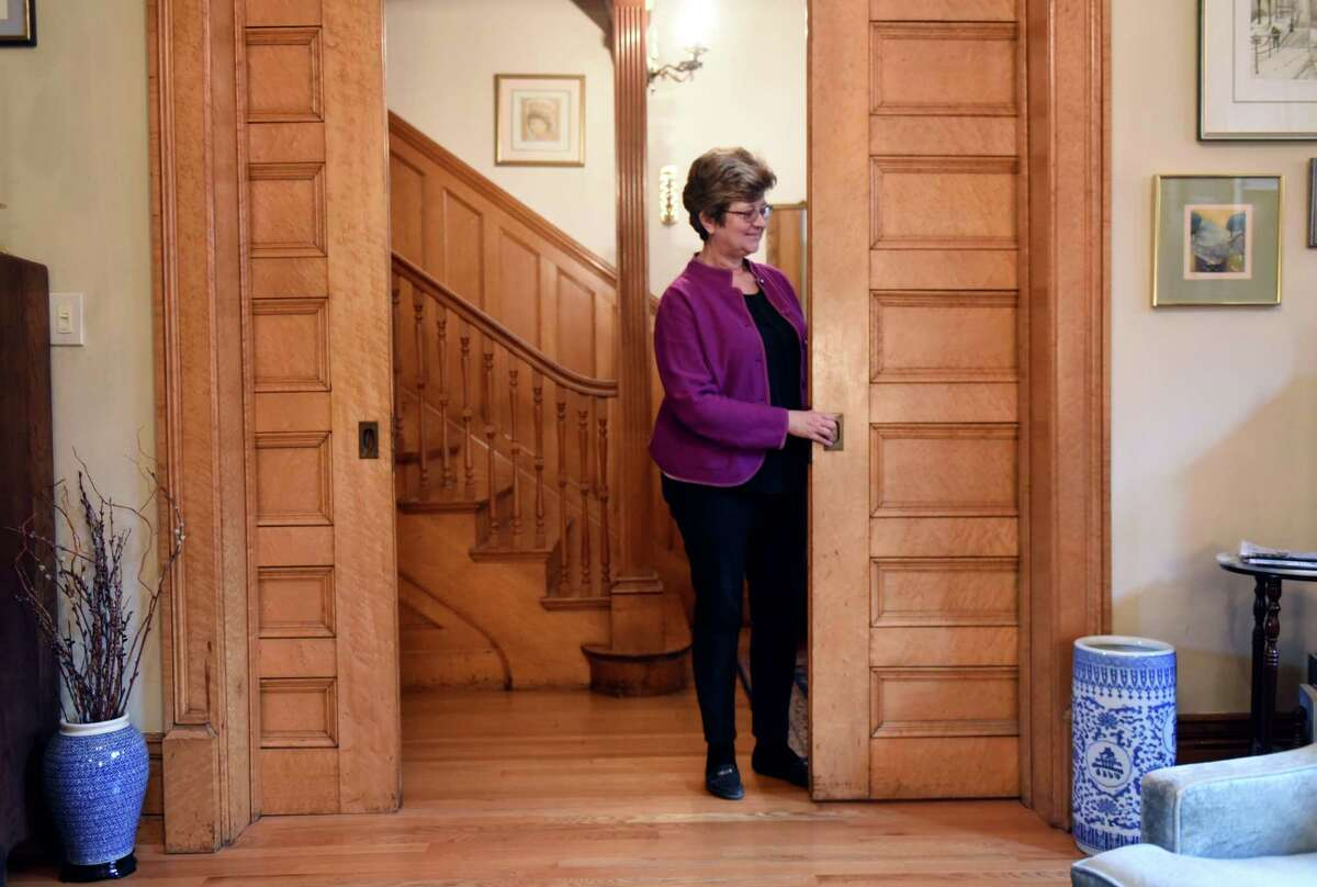 Karin Krasevac-Lenz pulls out one of the maple pocket doors inside her Second Street home on Tuesday, Feb. 4, 2020, in Troy, N.Y. The Hart Cluett Museum executive director hopes her home will be featured in a new HBO production titled