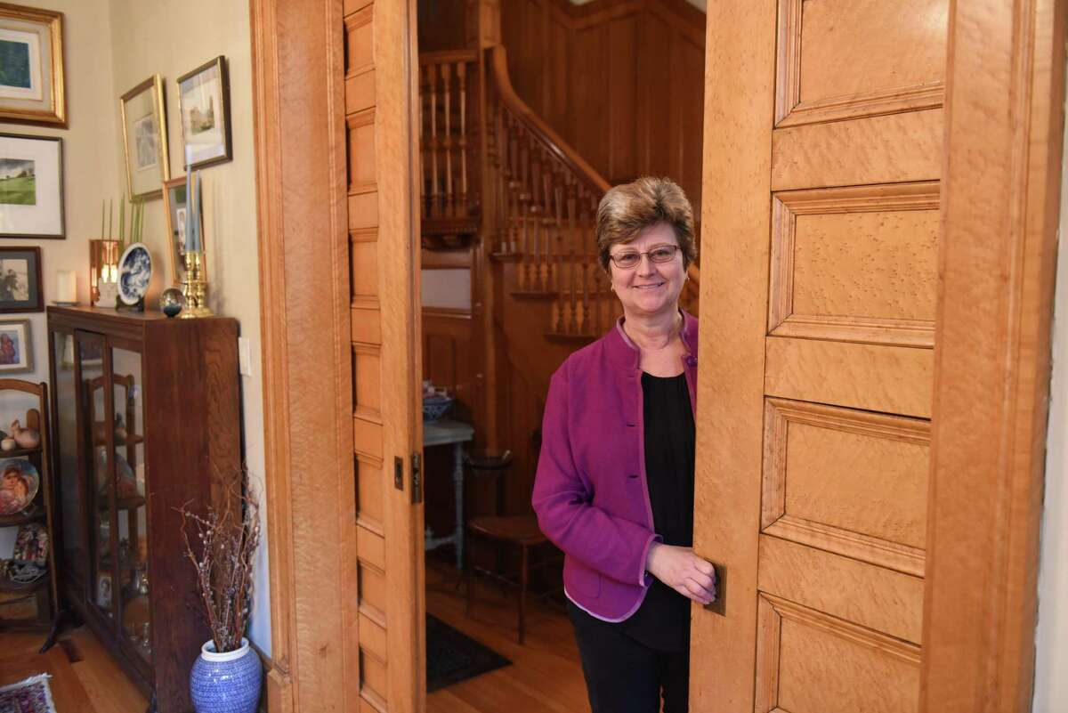 """Karin Krasevac-Lenz is pictured inside her Second Street home on Tuesday, Feb. 4, 2020, in Troy, N.Y. The Hart Cluett Museum executive director hopes her home will be featured in a new HBO production titled """"The Gilded Age,"""" written by the writer for """"Downton Abbey."""" Filming is slated for June. (Will Waldron/Times Union)"""