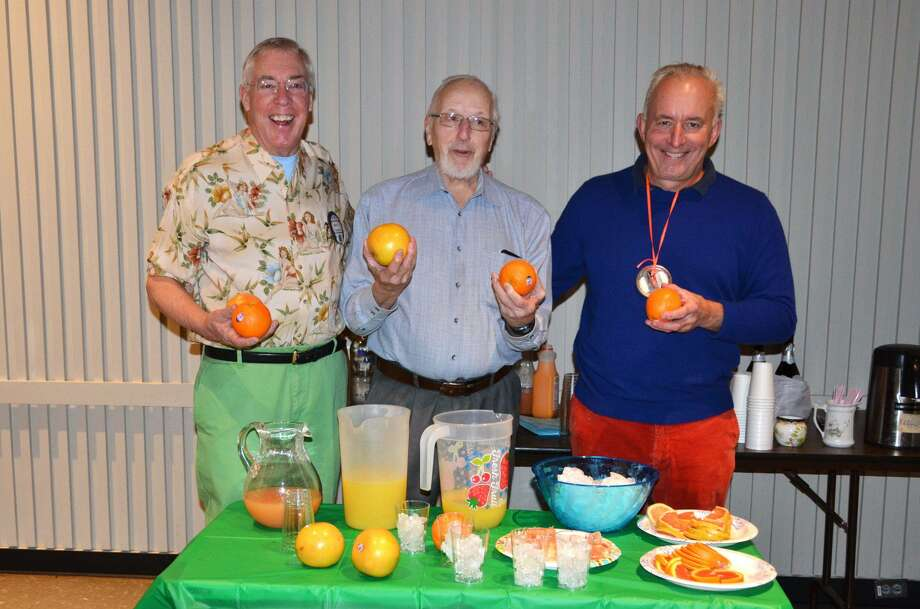 Kiwanians Marty Clancy, left, Bud Taylor and Mike Safko demonstrate some ways to use the juice of the oranges and grapefruits the club is offering in their annual fundraiser — mimosas, screwdrivers and more. Photo: Contributed Photo / Wilton Kiwanis Club / Wilton Bulletin Contributed